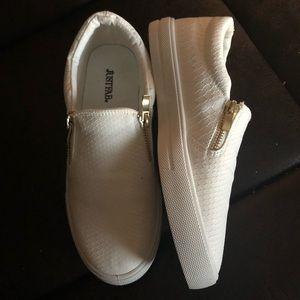White slip-on sneakers